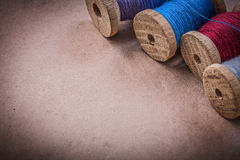 Reels of sewing threads on vintage background Royalty Free Stock Photos
