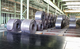 Reels of steel plate in shop. Finished reels of hot milled steel plate is piled in shop stock photo