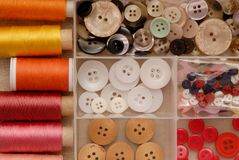 Reels of thread and buttons Royalty Free Stock Image