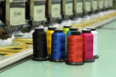 Reels of thread. With Machine embroider background Stock Photography
