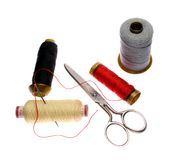 Reels of thread, needle and  scissors.  Stock Photography