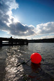 Reen Pier. Afternoon sun at Reen Pier, Co.Cork, Ireland with red marker bouy in foreground Stock Photos