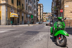 Reen vespa parking at Napoli street, Laspezia, Italy Stock Photo