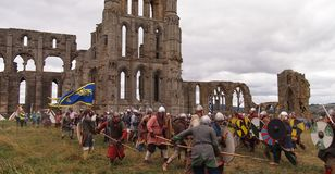 Reenactment of a battle between Vikings and Saxons Whitby in Northern England. A battle between Vikings and Anglo-Saxons at the ruin of Whitby Abbey, Great stock photos