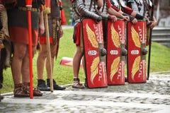 Reenactment com os uniformes romanos dos soldados Fotografia de Stock Royalty Free