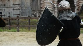 Reenactment of medieval martial arts tournament by actors wearing armor suits. Stock footage stock video