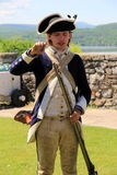 Reenactment of soldier filling weapon,Fort Ticonderoga,New York,2014 Royalty Free Stock Photo