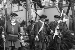Reenactment Soldiers War St Augustine. Four reenacting war soldier march on the streets of St Augustine, Florida royalty free stock image