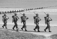 Reenactment of World War 2 battle. Blyth, Northumberland, May 16. 2015. Reenactors, dressed as World War 2 British soliders in reenactment of beach landing at Stock Photos