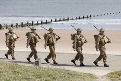 Reenactment of World War 2 battle. Blyth, Northumberland, May 16. 2015. Reenactors, dressed as World War 2 British soliders in reenactment of beach landing at Stock Image