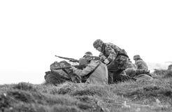 Reenactment of World War 2 battle. Blyth, Northumberland, May 16. 2015. Reenactors, dressed as World War 2 German soliders in reenactment of beach landing at Royalty Free Stock Image