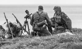 Reenactment of World War 2 battle. Blyth, Northumberland, May 16. 2015. Reenactors, dressed as World War 2 German soliders in reenactment of beach landing at Royalty Free Stock Photos