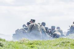 Reenactment of World War 2 battle. Blyth, Northumberland, May 16. 2015. Reenactors, dressed as World War 2 German soliders in reenactment of beach landing at Stock Photos