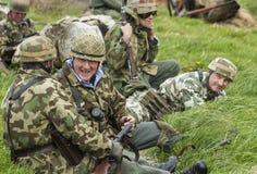 Reenactment of World War 2 battle. Blyth, Northumberland, May 16. 2015. Reenactors, dressed as World War 2 German soliders in reenactment of beach landing at Royalty Free Stock Photo