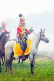 reenactor战士骑一个白马 免版税库存图片