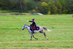 Reenactor dressed as Napoleonic war soldier rides a horse. Stock Photos