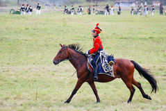 Reenactor dressed as Napoleonic war soldier rides a horse. Stock Photo