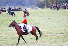 Reenactor dressed as Napoleonic war soldier rides a horse. Royalty Free Stock Image