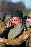 Reenactor speaks over the mobile phone Royalty Free Stock Image