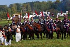 Reenactors одело по мере того как солдаты наполеоновской войны едут лошади Стоковое фото RF