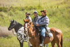 Reenactors confederados a caballo Imagen de archivo libre de regalías
