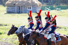 Reenactors-cuirassiers dressed as Napoleonic war soldiers ride horses Royalty Free Stock Image