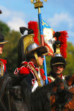 Reenactors - cuirassiers holding a French flag. Stock Photo