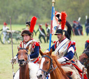 Reenactors dressed as Napoleonic war French soldiers ride horses Stock Images