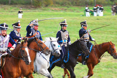 Reenactors dressed as Napoleonic war Russian soldiers ride horses Stock Photo
