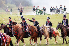Reenactors dressed as Napoleonic war soldiers attack. Stock Image