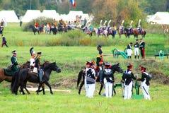 Reenactors dressed as Napoleonic war soldiers fight. Stock Image