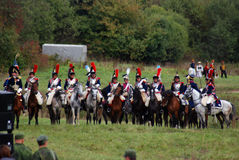 Reenactors dressed as Napoleonic war soldiers ride horses Royalty Free Stock Photos