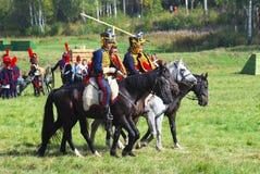 Reenactors dressed as Napoleonic war soldiers ride horses Stock Photos