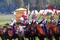 Reenactors dressed as Napoleonic war soldiers ride horses Stock Images