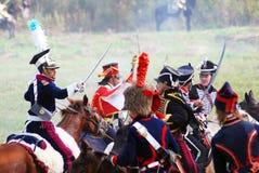 Reenactors dressed as Napoleonic war soldiers ride horses Stock Images