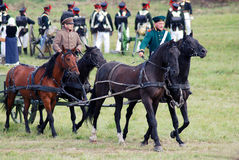 Reenactors dressed as Napoleonic war soldiers ride horses Royalty Free Stock Image