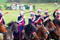Reenactors dressed as Napoleonic war soldiers ride horses Stock Photos