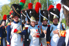 Reenactors dressed as Napoleonic war soldiers stand holding guns Royalty Free Stock Photo