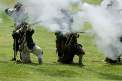 Reenactors firing. Muskets during a demonstration in California Royalty Free Stock Images