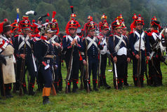 Reenactors group portrait. They stand holding guns. Stock Photography