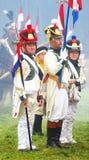 Reenactors klädde, som franskan tjäna som soldat Arkivfoton