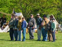 A Reenactors Marching in an Open Field royalty free stock photos