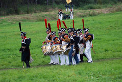 Reenactors-musicians march holding drums Royalty Free Stock Images