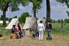 Reenactors pioneers, militia, soldiers, traders at Bent`s Old Fort. Reenactors portray pioneers, militia, soldiers, traders at annual Living History Encampment Royalty Free Stock Photography