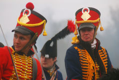 Reenactors portrait. They wear red hats decorated by golden rhombs. Stock Photos