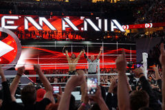 Ref raises Seth Rollins arms as he celebrates with fans victory Royalty Free Stock Images