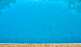Refection of Blue water in Swimming pool with brick pavement Stock Photo