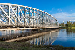 Refection of bridge upon the river in Finland royalty free stock photos