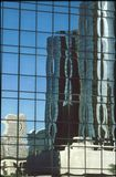 Refections in Glass. Reflections of buildings in a glass building stock photo