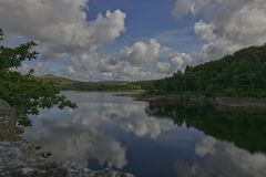 Refections of Sky in Water. Refections of sky in Burrator reservoir, on a sunny day stock photos